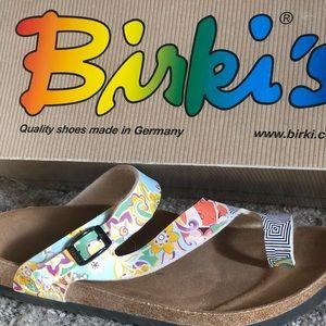 Birkenstock's Sandals White/pastel blue pattern.